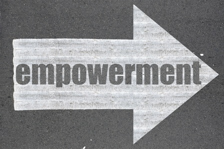 Arrow on asphalt road written word empowerment
