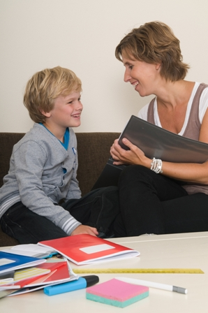 Teacher talking to a young student