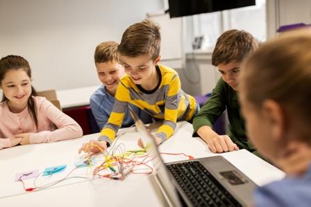 Elementary school kids using a computer