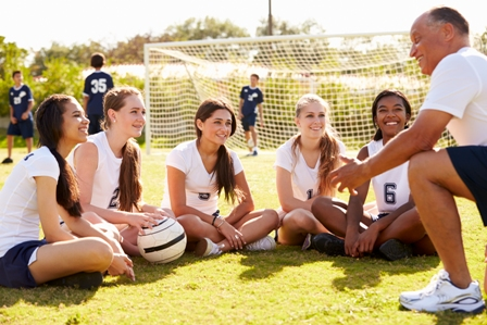 A soccer coaching talking to players