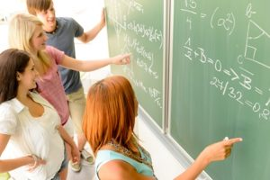 Students around the chalkboard