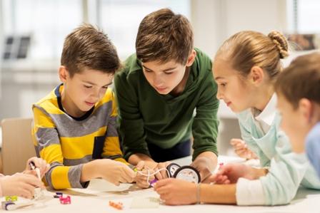 children putting robot together