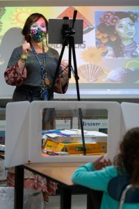 An elementary art teacher instructs second-grade students attending in person and remotely at Wesley Elementary School. <br />